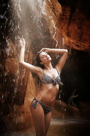 Sexy brunette enjoying jungle waterfall Stock Photo - 9070953