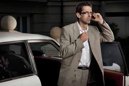 Handsome man speaking the phone photo