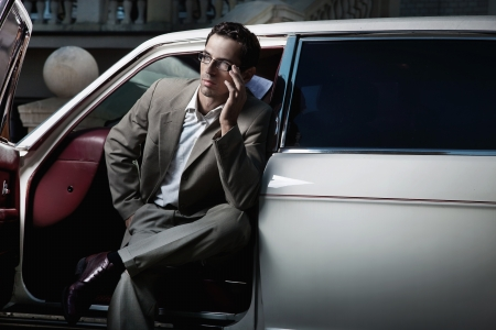 Handsome man sitting in the car Stock Photo - 9077232