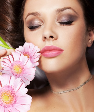 Portrait of a beauty lady with flowers photo