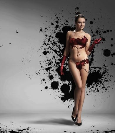 Beauty brunette with paint splash photo