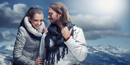 Smiling couple in the mountain photo