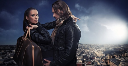 Young couple over the city background Stock Photo - 9077254