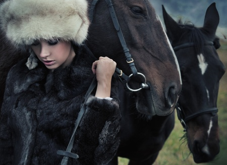 Nostalgic young brunette posing next to a horse Stock Photo - 9070936