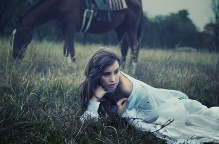 Fine art photo of a young beauty on the grass Stock Photo - 9070925