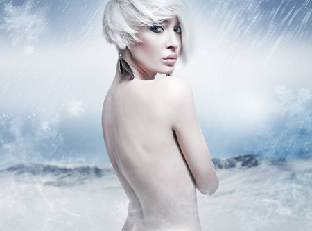 Beauty blonde in the winter scenery photo