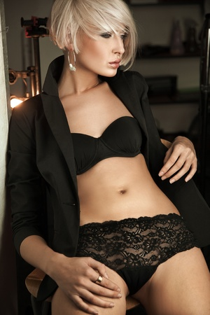 dark blond: Attractive young woman posing in lingerie