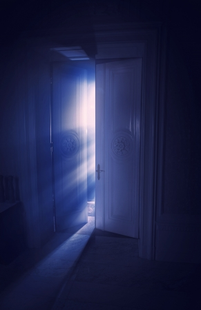 Blue rays of light behind the door photo