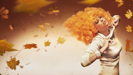 Young beauty on autumn studio background photo