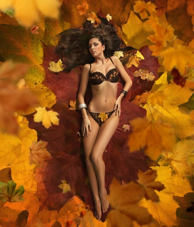 Cute woman laying on the leaves photo