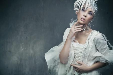 Beauty brunette wearing fashionable dress Stock Photo - 9189397