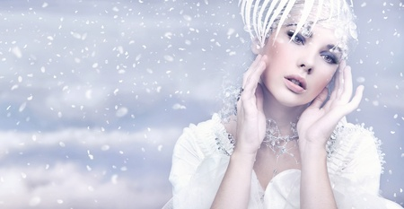 Beauty woman over winter background photo
