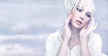 Beauty woman over winter background Stock Photo - 9188764