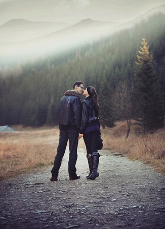 romantic sexy: Young couple walking and holding hands