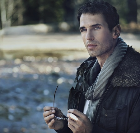 sweaters: Outdoors portrait of a young man