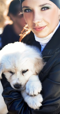 Young woman holding puppy Stock Photo - 9189148