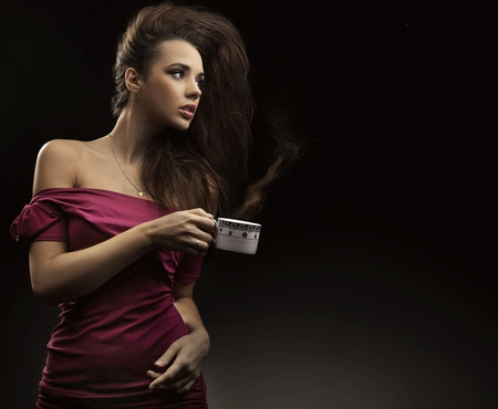 Sexy woman holding cup of tea photo
