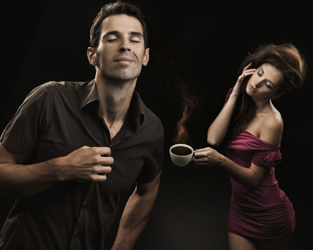 Young couple drinking coffee photo