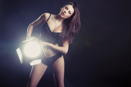 Sexy woman with lamp photo