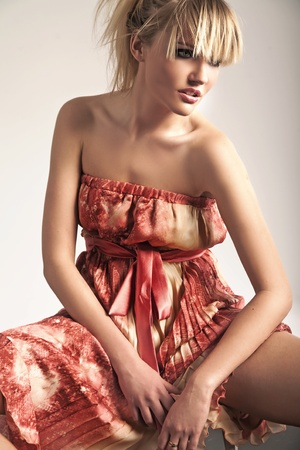 Beauty blonde wearing romantic dress photo
