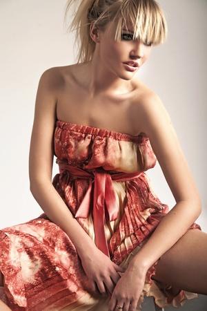 Beauty blonde wearing romantic dress photo