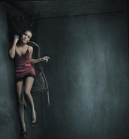 deseo sexual: Fotos de obras de arte de una mujer en la silla