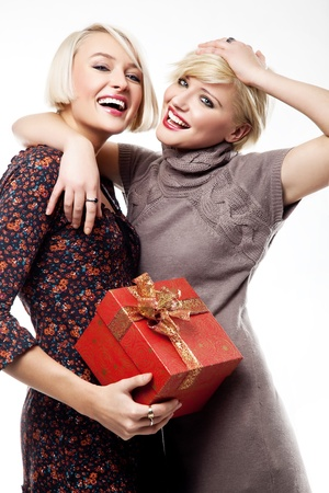 beauties: Two blond beauties holding a christmas present