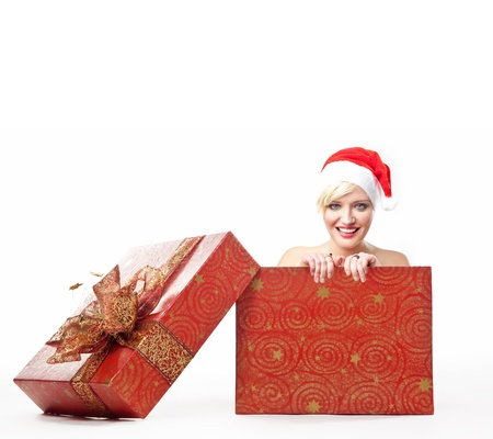 Cheerful santa woman in a christmas box photo