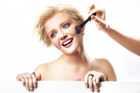 Portrait of a woman doing make up photo