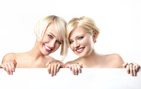 Young girls smiling on the white background photo