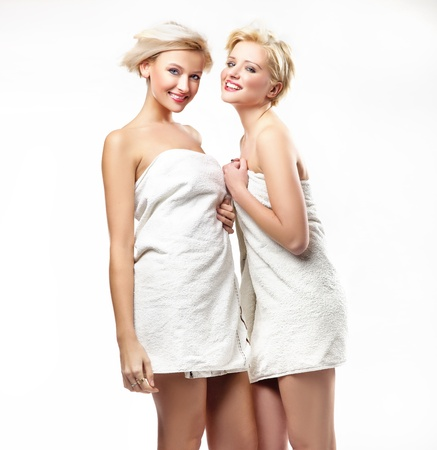 Smiling girls in towels photo