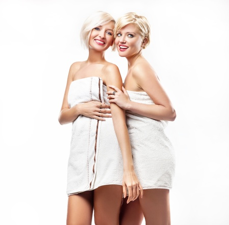Young women in bath towels photo