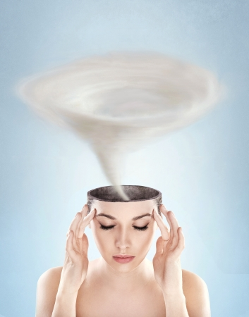 Conceptual picture - tornado in womans head photo