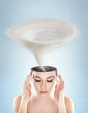 Conceptual picture - tornado in woman's head
