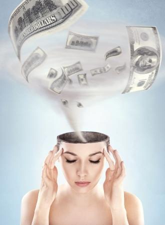 savings problems: Dollars tornado in womans head Stock Photo