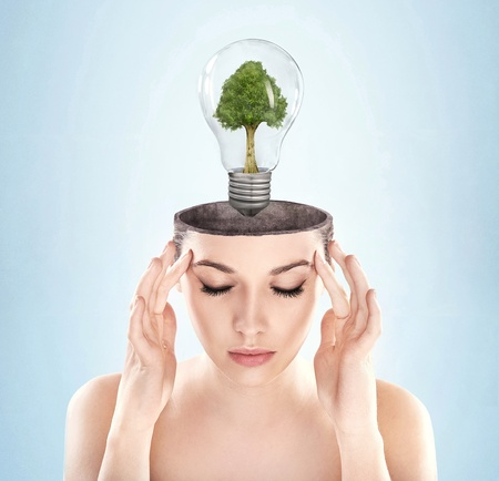 Open minded woman with green energy symbol Stock Photo - 9234005