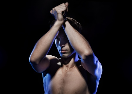 Portrait of a young muscular man photo