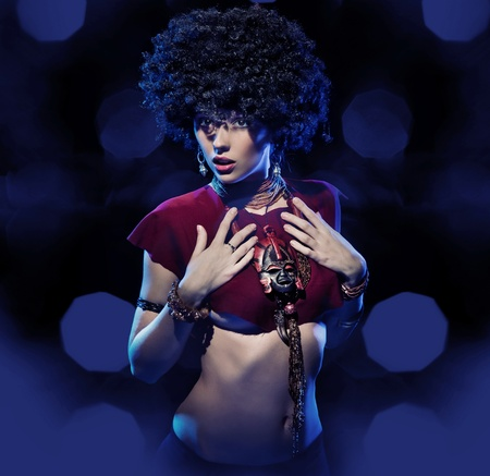 Beautiful woman with huge afro haircut photo