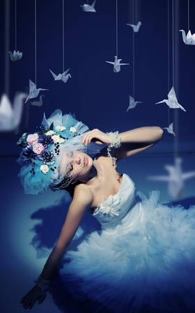 Winter woman with origami photo