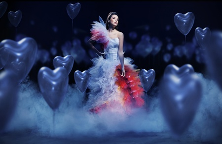 mystical woman: Young woman in the mist with hearts