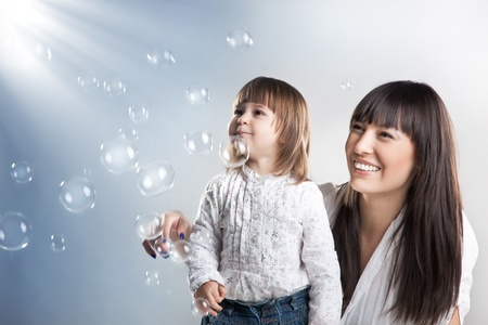 Smiling woman and her daughter photo