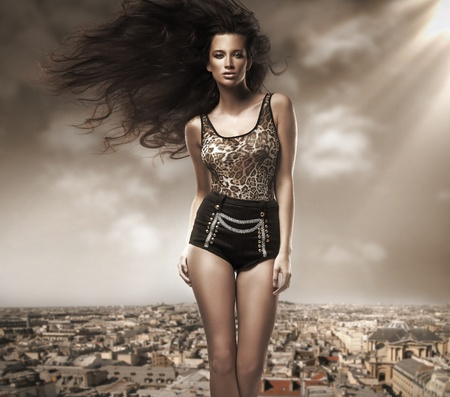 Fresh young beauty over cityscape background photo
