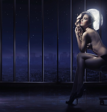 brunette beauty posing at full moon Stock Photo - 9316605