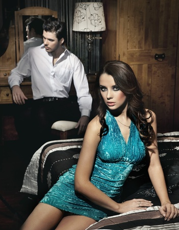 closeness: Handsome young couple resting in bedroom before night party