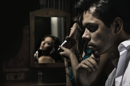 sexual intimacy: Portrait of handsome man and pretty girl doing make up