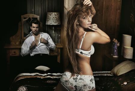 Amazing sexy couple having fun in romantic room