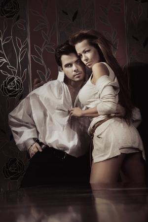 sexual intimacy: Young sexy couple in romantic pose
