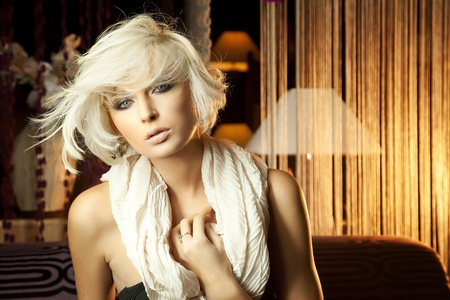 Portrait of beautiful blonde with scarf photo