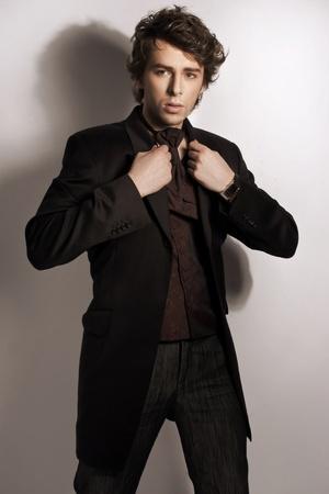 Fashionable man posing in elegant clothes photo