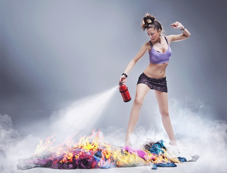Nice girl irl is extinguishing the fire of clothes Stock Photo - 9336043